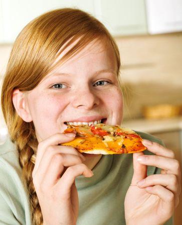 one teenage girl only: Teenage girl comer pizza