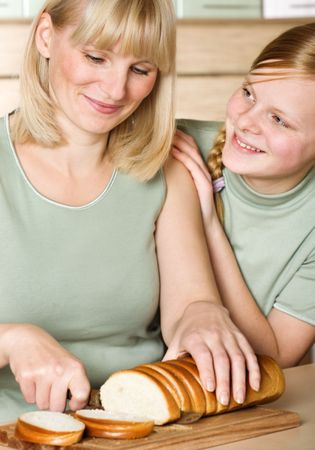 Mother and daughter in kitchen Stock Photo - 5911192