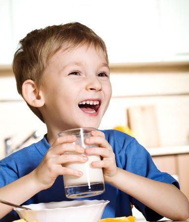 Happy boy with milk