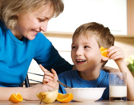 Happy mother and son in kitchen photo