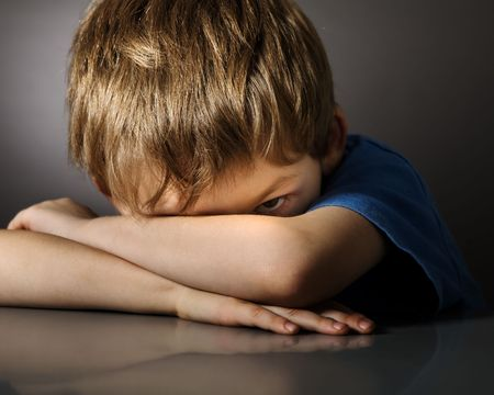 negative thinking:  Boy in depression Stock Photo