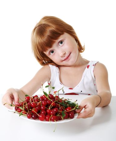 Little girl with cherry photo
