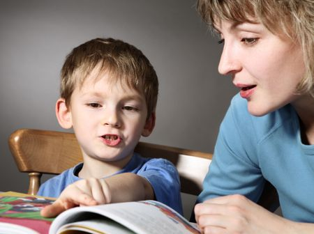 Mother teach son to read Stock Photo