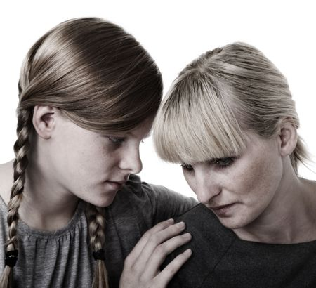 Daughter consoles mother photo