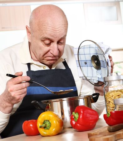 Mature man cooking