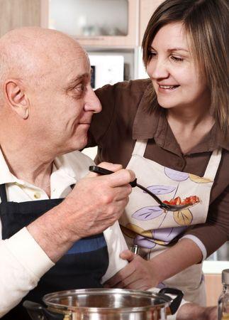Senior couple preparing food photo