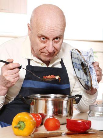 only senior men: Senior man tasting food Stock Photo