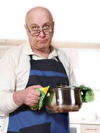 bald man: Senior man cooking