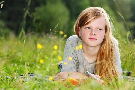 freckled: Teenage girl on meadow