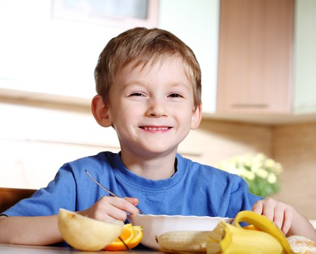 eating banana: Tasty breakfast of little boy