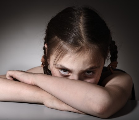 Little girl in depression  Stock Photo