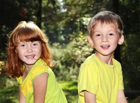 Happy children in forest  photo