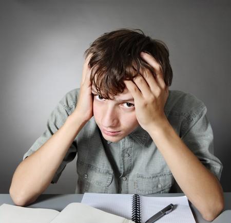 Thinking schoolboy Stock Photo