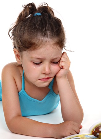 alone and sad: Little girl in tears
