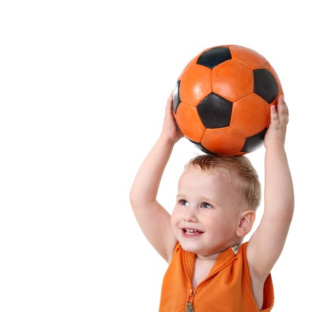 baby play: Little boy holding soccer ball  Stock Photo