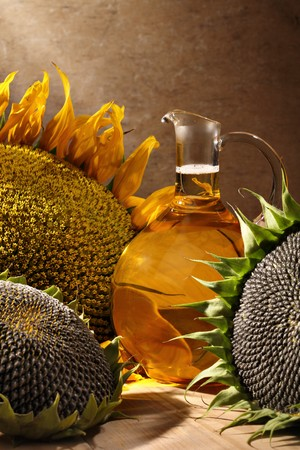 Oil bottle with sunflowers Stock Photo