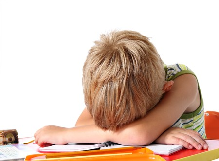 homework: Tired school boy Stock Photo