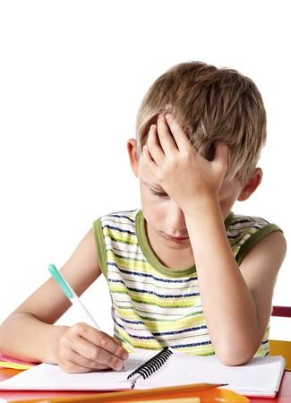 Schoolboy doing homework Stock Photo - 7782559