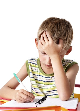 kids writing: Schoolboy doing homework