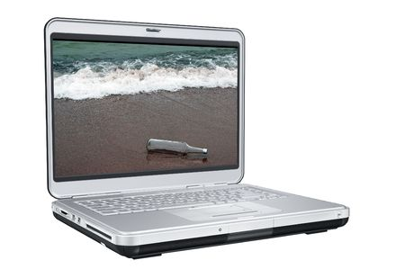 message bottle: Laptop Computer With Message in the bottle On Screen
