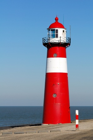 Red lighthouse in Zeeland, Netherlands photo