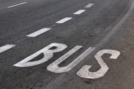 Bus stop label on the asphalt Stock Photo - 13667454