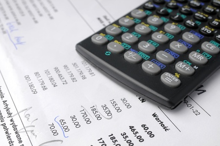 reckon: The calculator and documents Stock Photo