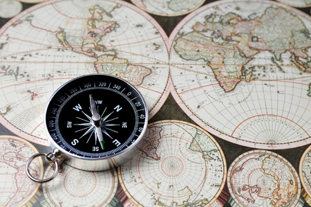 Close up view of the compass on old map photo