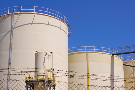 Oil and gas industry  Oil reservoirs on a petrochemical plant photo