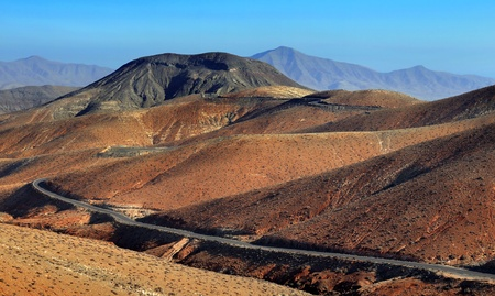 Winding road across the dunes, in the Canary Islands, Spain  photo