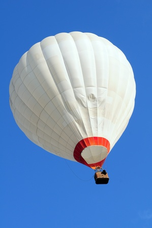 Hot air balloon in the blue sky photo
