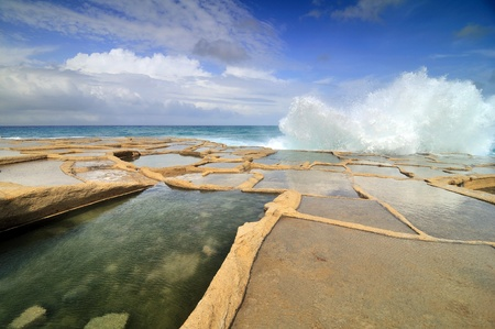 Old salt evaporation ponds, Malta island Stock Photo - 13777296