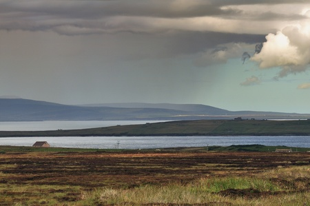Rain shower over Orkney Islands, North Scotland photo