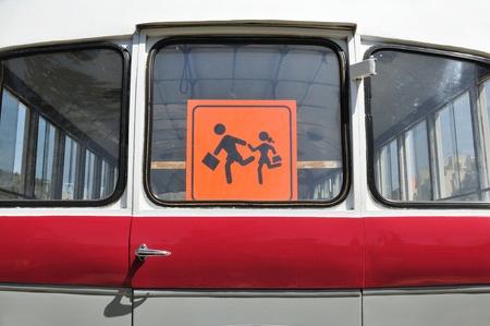 schoolbus: Child sign on rear bus window