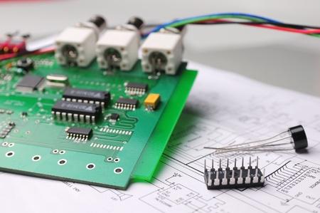Close-up on a microchip on a scheme background photo