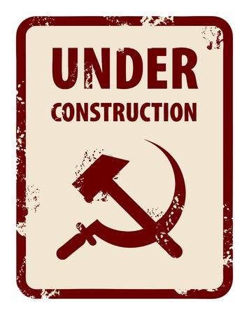 communistic: Sello de grunge con la hoz y el martillo y las palabras escritas en construcci�n en el interior del sello