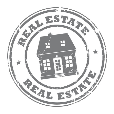 Grunge rubber stamp with house and the text real estate written inside the stamp
