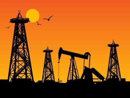 torre de perforacion petrolera: Siluetas de plataformas petroleras y el cielo de color naranja