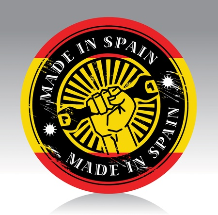 made in spain: Abstract label with hand holding wrench and words made in spain