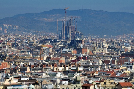 BARCELONA - MARCH 12: Barcelona city panorama with Sagrada Familia cathedral in Barcelona, Spain. It was created by famous Catalan archtect Antonio Gaudi. March 12, 2012 Barcelona, Spain. Stock Photo - 16205728