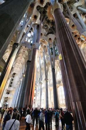 unrealistic: BARCELONA - MARCH 12: interior of Sagrada Familia cathedral in Barcelona, Spain. It was created by famous Catalan archtect Antonio Gaudi. March 12, 2012 Barcelona, Spain.