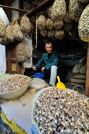 FES - MARCH 10: Unknown man trades a snails in a Market (souk) in a city Fes in Morocco. The market is one of the most important attractions of the city. March 10, 2012 Fes, Morocco. Stock Photo - 16532397