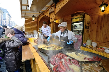 tradespeople: VILNIUS, LITHUANIA - MARCH 1: Unidentified people trades food in annual traditional crafts fair - Kaziuko fair on Mar 1, 2013 in Vilnius, Lithuania