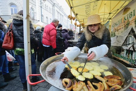 VILNIUS, LITHUANIA - MARCH 1: Unidentified people trades food in annual traditional crafts fair - Kaziuko fair on Mar 1, 2013 in Vilnius, Lithuania Stock Photo - 18328939