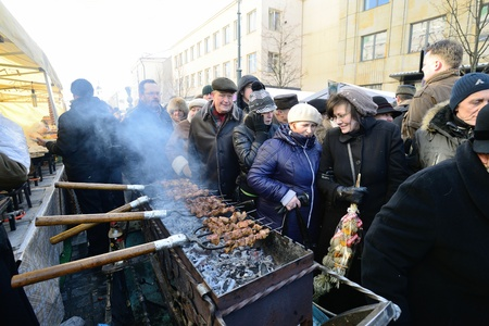 tradespeople: VILNIUS, LITHUANIA - MARCH 2: Unidentified people trades food in annual traditional crafts fair - Kaziuko fair on Mar 2, 2013 in Vilnius, Lithuania