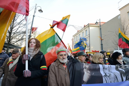 nationalist: VILNIUS, LITHUANIA - MAR 11: Around one thousand people gathered with flags in a nationalist rally at Gedimino Avenue in central Vilnius on Re-Establishment of Independence Day on March 11, 2013.