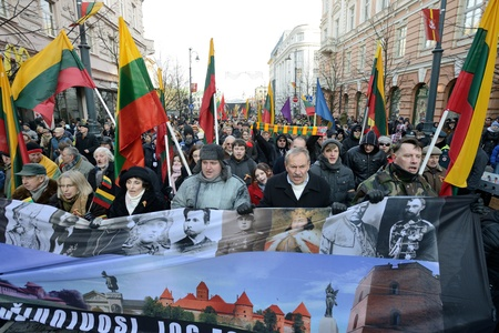 reestablishment: VILNIUS, LITHUANIA - MAR 11: Around one thousand people gathered with flags in a nationalist rally at Gedimino Avenue in central Vilnius on Re-Establishment of Independence Day on March 11, 2013.