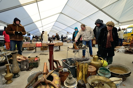 KAUNAS, LITHUANIA - MAR 23: Unidentified people in a traditional flea market in second biggest Lithuanian city - Kaunas, on March 23, 2013 in Kaunas, Lithuania Stock Photo - 18614148