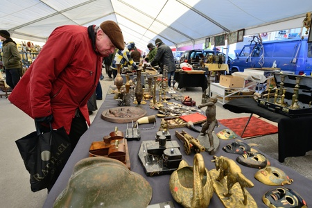 kaunas: KAUNAS, LITHUANIA - MAR 23: Unidentified people in a traditional flea market in second biggest Lithuanian city - Kaunas, on March 23, 2013 in Kaunas, Lithuania