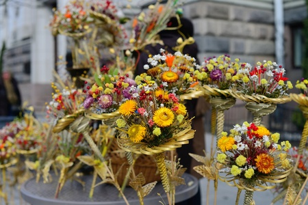 palm sunday: VILNIUS, LITHUANIA - MARCH 24: Unidentified peoples trades traditional palm bouquets on Palm Sunday fair on Mar 24, 2013 in Vilnius, Lithuania